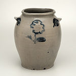"Fig. 11: Storage jar by John Swann, 1819–1822, Alexandria, VA. Impressed ""JSWANN/ ALEXA."" on side of body. Salt-glazed stoneware with cobalt decoration; HOA: 10-1/2"", WOA: 8-3/4"". MESDA, The William C. and Susan S. Mariner Collection, Acc. 5813.22. Photo by Dan Routh."