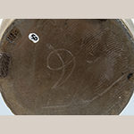 "Fig. 18: Detail of base inscribed ""D"" on base of bottle illustrated in Fig. 13. Photo by Dan Routh."