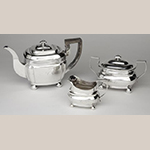 "Fig. 21: Three-piece tea service marked by Asa Blanchard, ca. 1820, Lexington, KY. Silver; Teapot: HOA: 7; Sugar Bowl: HOA 4-3/4""; Cream Pitcher: HOA 4"". Private Collection; Photograph courtesy of the Kentucky Online Arts Resource (The Speed Art Museum), 2011.34.23, 2011.34.27, and 2011.34.31. Photograph by Bill Roughen."