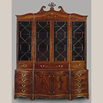 "Fig. 6: Library bookcase attributed to the Martin Pfeninger Shop, 1770-1780, Charleston, SC. Mahogany and mahogany veneer with inlay of ivory and various unidentified woods and secondary woods of mahogany, cypress, and white pine; HOA: 128-3/4"", WOA: 99"", DOA: 20-1/2"". Charleston Museum Acc. HF 357. Photograph by Gavin Ashworth, NYC. MESDA Object Database file S-8000."