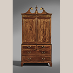 "Fig. 17: Linen press attributed to the Jacob Sass Shop. 1790-1800, Charleston, SC. Mahogany and mahogany veneer with yellow pine and white cedar; HOA: 96"", WOA: 50-1/4"", DOA: 24-3/4"". Private collection. MESDA Object Database file S-16983."