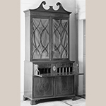 "Fig. 37: Secretary bookcase attributed to the John Gros Shop, c.1798-1804, Charleston, SC. Mahogany and mahogany veneer with yellow pine and white pine; HOA: 105-5/8"", WOA: 50-1/4"", DOA: 24"". Private collection. MESDA Object Database file S-11329."