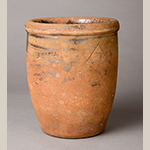 """Fig. 10: Earthenware crock with lead-glazed interior attributed to Abraham Spencer working in Solomon Bell's pottery, 1850-1873, Strasburg, VA. Stamped """"SOLOMON BELL / STRASBURG, VA"""" and incised with an """"A"""" on outside of body. Private collection."""