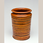 """Fig. 3: Lead-glazed, slip-decorated earthenware vase attributed to Christian Adam or Jacob Adam, 1813–1835, New Market, VA. HOA 7-3/4"""". Museum of the Shenandoah Valley, Acc. 2001.0013.06."""