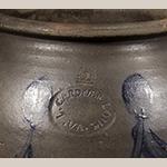 "Fig. 3: Detail of impressed stamp ""L. GARDNER / LOUN. VA."" on the jar illustrated in Fig. 2. Photograph courtesy of Jeffrey S. Evans & Associates."