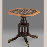 "Fig. 3: Chess table; tabletop: unknown artist, 1809, Rome, Italy; base: attributed to John C. Bowie (1786–1851) and/or Walter Bowie (1790–1853), 1820, Port Royal, VA. Inscribed in ink on a torn paper label adhered to top of base: ""J Bernar…/ Gay… ."" Mahogany and black walnut with brass, slate, marble, limestone, lapis lazuli, malachite, and other stones; HOA: 27-1/8"", WOA: 24-3/4"", DOA: 24-7/8"". Collection of Colonial Williamsburg Foundation, Acc. 2015-341, Museum Purchase and TIF Foundation in memory of Michele Iverson."