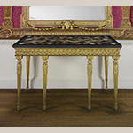 "Fig. 10: Side table; tabletop John Wildsmith (w.1757–1769), London, England, 1759, base by John Mayhew (1736–1811), London, England, 1794. Carved and gilded pine with marbles (including rosso and nero antico, orange Veronese, yellow Siena, brown, gray, and white fleur de pêcher, black and gold Portor, orange and violet Spanish brocatello, and white Carrara, and hardstones, including gray and red granite, red and white jasper, pink quartz, porphyry, bloodstone, serpentine, golden and brown agate and onyx, and lapis lazuli); HOA: 37"", WOA: 60-1/4"", DOA: 31-1/8"". Collection of the Metropolitan Museum of Art, Acc. 58.75.130a, b; Gift of Samuel H. Kress Foundation."