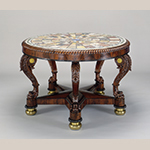 "Fig. 12: Center table by Anthony Gabriel Quervelle (1789–1856), 1826–1830, Philadelphia, PA. While this table does not have a provenance it is identical to a marble-top center table documented as being owned by the Edward Coleman Family of Pennsylvania that was one of a pair. Mahogany and mahogany veneers with white pine, various marbles, and brass; HOA: 30-1/8"", DIA: 46-3/4"". Collection of the Baltimore Museum of Art, Acc. 1990.73; Friends of the American Wing Fund; Decorative Arts Acquisitions Endowment established by The Friends of the American Wing; and purchase with exchange funds provided by eighteen Donors."