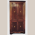 "Fig. 45: Corner cupboard, 1800–1820, Washington Co. or Greene Co., TN. Cherry with tulip poplar and lightwood inlay; HOA: 88"", WOA: 42-3/4"". Private collection; MESDA Object Database file S-2648."
