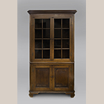 "Fig. 73: Corner cupboard, ca. 1800 with later inlay additions, attributed to Greene Co., TN. Walnut with oak, yellow pine, chestnut and lightwood and darkwood inlay; HOA: 86-1/4"", WOA: 49-1/2"". Collection of the Tennessee State Museum, Acc. 78.19.249a, Nashville, TN."