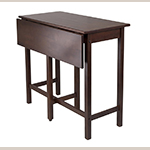 "Fig. 34: ""Lynnwood"" drop-leaf high table by Winsome. Solid wood in antique walnut finish; HOA: 35-7/16"", WOA: 39-1/3"", DOA: 20-3/4"" (closed), 30"" (open)."
