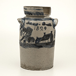 "Fig. 1: Butter churn, Thomas Mitchel Chandler Jr. (1810–1854), 1829, Baltimore, MD. Inscribed on bottom: ""Thomas M. Chandler / Maker / Baltimore/ August / 12 / 1829."" Salt-glazed stoneware with cobalt decoration; HOA: 10-3/4"", WOA: 7"". MESDA, The William C. and Susan S. Mariner Collection, Acc. 5813.47."