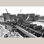 Fig. 20: Construction photo of the Santee-Cooper project showing cranes over the Pinopolis Power Plant. Photo courtesy of Santee Cooper.