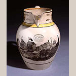 "Fig. 6: ""Shell Castle Island"" pitcher, 1805-1810, Liverpool, England. Pearlware; HOA: 32.9 cm; WOA: 32.7 cm; DIA: 26.2 cm. North Carolina Museum of History, acc. H.1933.12.51. Online: http://collections.ncdcr.gov/dcr/ProficioScript.aspx?IDCFile=DETAILS.IDC,TITLE=NEW%20SEARCH,URL=search.html,SPECIFIC=51696,DATABASE=WebTagSet635375777359179608, (accessed 27 May 2014)."