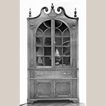 "Fig. 54: Corner cupboard attributed to Mordecai Collins and possibly Jacob Clodfelter, ca. 1810, Davidson Co., NC. Walnut with yellow pine; HOA: 96"", WOA: 40"", DOA: NR. Private collection. MESDA Object Database file S-1054."
