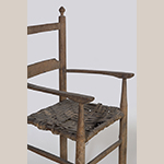 Fig. 104: Detail of an armrest on the high chair illustrated in Fig. 101.