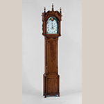 "Fig. 8: Tall Clock with case attributed to John Brown (1761–1835) and movement attributed to clockmaker Hugh Andrews (1761–1821), 1800–1805, Wellsburg, WV. Finials and fluted plinths replaced; shaped skirt restored. Cherry and cherry veneer with light and dark wood inlays and tulip poplar; HOA: 96"", WOA: 20-5/8"", DOA: 10-1/2"". MESDA Collection, Acc. 4357; available online: https://mesda.org/item/collections/tall-case-clock/2566/ (accessed 28 August 2019); Photograph by Wes Stewart."