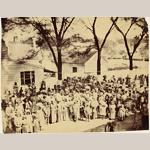 "Fig. 1: Slaves, J.J. Smith's Plantation, South Carolina by Timothy H. O'Sullivan (b.c.1840–1882), Beaufort, SC, 1862. Albumen print;HOA: 8-7/16"", WOA: 10-3/4"". Collection of the J. Paul Getty Museum, acc. 84.XM.484.39."