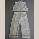 "Fig. 5: Child's ""slave cloth"" sleeveless jacket and pants, unknown maker, Louisiana, 1850s. Cotton; hand spun and woven. From the Collections of Shadows-on-the-Teche, a Site of the National Trust for Historic Preservation, New Iberia, Louisiana, acc. NT59.67.644 (5B)."