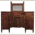 "Fig. 6: Sideboard by John C. Burgner, 1817–1818 (lower case) and 1856 (mirror and upper glove drawers), Greene Co. or Washington Co., TN. Walnut and cherry with tulip poplar; HOA: 72-1/4"", WOA: 72"", DOA: 25"". Feet replaced. Private collection, photograph courtesy Brunk Auctions, Asheville, NC."