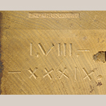 Fig. 37: Detail of John C. Burgner's tool stamp and inscribed date on the top of the left post of the sideboard in Fig. 35. The marks are only visible when the top is removed.