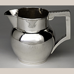 "Fig. 10: Pitcher marked by Asa Blanchard (with manufacturer mark of John McMullin, Philadelphia, PA), ca. 1815, Lexington, KY. Silver; HOA: 7"", WOA: 8-1/2"", DOA: 6-1/2"". Private Collection; Photograph courtesy of the Kentucky Online Arts Resource (The Speed Art Museum), 2011.34.10. Photograph by Bill Roughen."