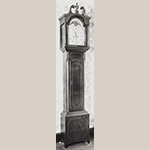 "Fig. 31: Tall case clock with case attributed to Robert Walker III (w.1800–1809), 1809, Port Royal, VA and movement by Goldsmith Chandlee (1751–1821), 1809–1811, Winchester, VA. Inscribed on label inside clock: ""This clock and____ made by / Robert Walker 22nd Aug / 1809 the movement____ / clock by Goldsmith Chand / lee of Winchester in____ 1 decembr: 18__ price of case____.35 of the mov.mt____total price 88.____"" . Cherry and cherry veneer with walnut, tulip poplar, and lightwood inlay; HOA: 98-1/2″, WOA: 27-7/8″ (hood), DOA: 10-1/2″. Private collection; MESDA Object Database File S-6266."