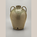 "Fig. 15: Water cooler, Thomas Mitchel Chandler Jr., 1850–1852, Greenwood Co., SC. Alkaline-glazed stoneware with slip decoration; HOA: 20"", DIA: 14"". MESDA, Loan courtesy of C. Philip and Corbett Toussaint, Acc. 5820.2"
