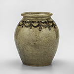 "Fig. 16: Jar, Thomas Mitchel Chandler Jr., 1836–1840, Edgefield Co., SC. Alkaline-glazed stoneware with slip decoration; HOA: 7-1/4"", DIA: 4-1/2"" (at top). MESDA, Acc. 1054.7."