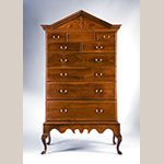 "Fig. 41: High chest on frame by Henry Macy, 1800–1820, Guilford Co., NC. Walnut with tulip poplar; HOA: 78-1/2"", WOA: 42-3/4"", DOA: 22-1/2"". MESDA Collection, Acc. 5442; Gift of Dr. Roy E Truslow in memory of his wife Caroline Gray Truslow and her parents Dr. and Mrs. Eugene Price Gray."
