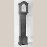 "Fig. 42: Tall case clock with case by Henry Macy, 1800–1820, Guilford Co., NC. Descended in the Hockett family of Guilford County. Walnut and cherry with tulip poplar; HOA: 89-1/4"", WOA 17"", DOA 9-3/4"". Private Collection; MESDA Object Database file S-2451."