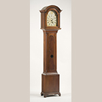 "Fig. 44: Tall case clock with case by Henry Macy, 1800–1820, Guilford Co., NC. This is the only known clock case attributed to the Macy shop with a decoratively lobed front glass; some of Macy's clock cases also feature small drawers at the bottom of the case. Walnut with tulip poplar; HOA: 91-1/4"", WOA 20-1/4"", DOA 11-3/4"". MESDA Collection, Acc. 5320; Promised gift of Mr. and Mrs. Lee French, Mr. and Mrs. Spencer Morten, and Dr. and Mrs. William Bell."