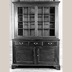 "Fig. 26: Side cupboard attributed to Jacob Clodfelter, ca. 1800, Davidson Co., NC. Walnut with walnut and yellow pine; HOA: 84-3/8"", WOA: 59-1/2"", DOA: 19-3/8"" (from upper molding of lower case to back). Private collection. MESDA Object Database file S-11542."