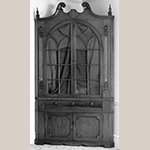 "Fig. 55: Corner cupboard attributed to Mordecai Collins and possibly Jacob Clodfelter, ca. 1810, Davidson Co., NC. Walnut, with walnut, yellow pine, and light- and dark-wood inlay; HOA: 99"" (with alterations), WOA: 49"", DOA: NR. Private collection. MESDA Object Database file S-11675."
