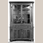 "Fig. 118: Corner cupboard by Jesse Clodfelter, 1844, Davidson Co., NC. Walnut with tulip poplar and light-wood inlay; HOA: 86-1/4"", WOA: 47-5/8"", DOA: NR. Private collection. MESDA Object Database file S-2902."
