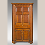 "Fig. 36: Corner cupboard by Moses Crawford, 1790-1800, Knox County, Tennessee. Walnut with yellow pine, tulip poplar, and oak inlay; HOA: 87-7/8"", WOA: 49-1/2"", DOA: 18-7/8"". Private collection, MESDA Research File 32,407."