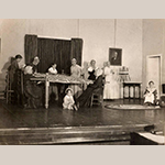 Fig. 79: Members of Hopewell-Centre Meeting in a historical reenactment during a benefit performance for the Civic League Milk Fund; unknown photographer, ca.1930. The chair in the left foreground with the broken upper slat might be the same chair recorded in MESDA Object Database file S-10679. This chair descended in the Lupton family of Apple Pie Ridge north of Winchester and came from the same house as the objects illustrated in Figs. 111, 112, and 114. Photograph courtesy Barbara Harner Suhay.