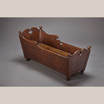 """Fig. 85: Cradle attributed to a member of the Fawcett family, probably John Fawcett Sr. (1716–1786) or Richard Fawcett (d.1789), 1740–1760, Frederick Co., VA. Walnut; HOA (at headboard): 19-3/4"""", WOA: 17-3/4"""", DOA: 41-3/8"""". Collection of the Museum of the Shenandoah Valley, Acc. 2017.04.1. Photograph by Ron Blunt."""